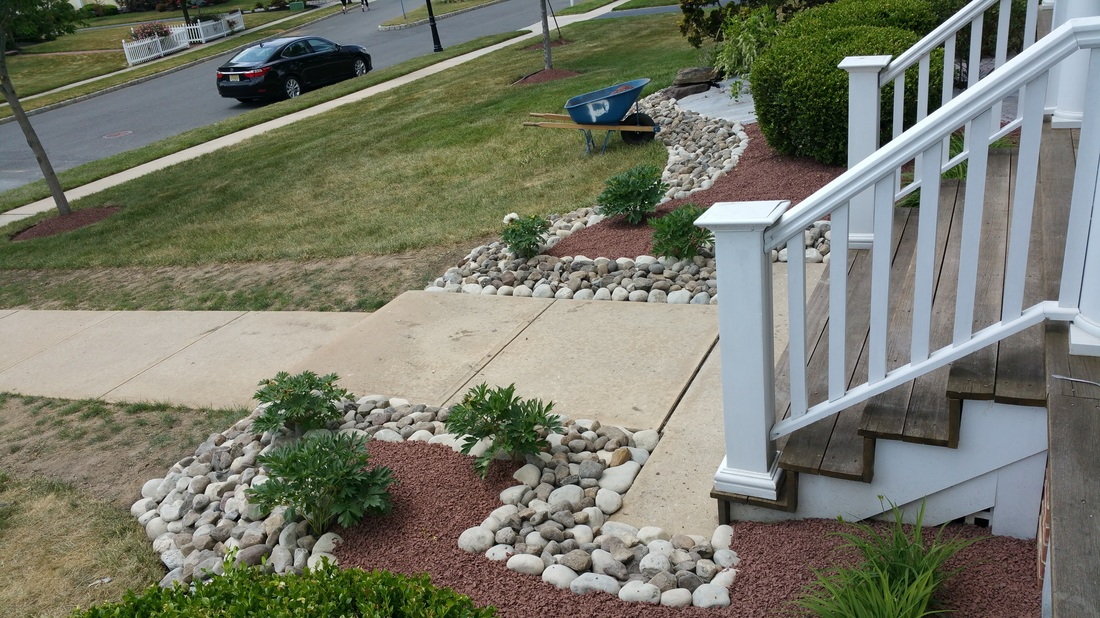 Elegant Stone Bordered Landscaped Entrance
